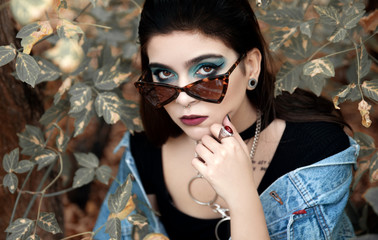 Young woman with sunglasses wearing denim jacket