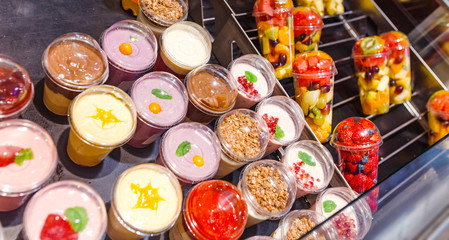 assortment of yogurt on display for sale at convenience store