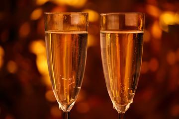 Champagne two glasses gold bokeh