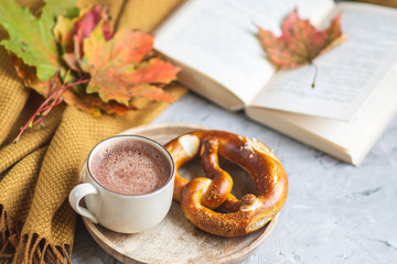 Tea Cup Hot Chocolate Coffee Autumn Time Bakery Pretzel Toned Photo Knitting Scarf Blanket Yellow Leaves Gray Background