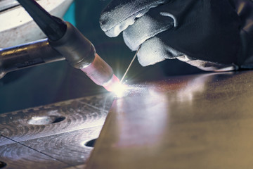 Metal welding process that uses a non-consumable tungsten electrode. Close-up.