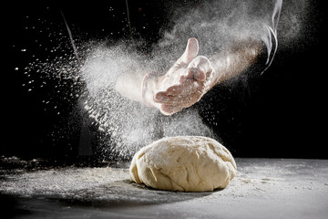 Chef scattering flour while kneading dough Fototapete