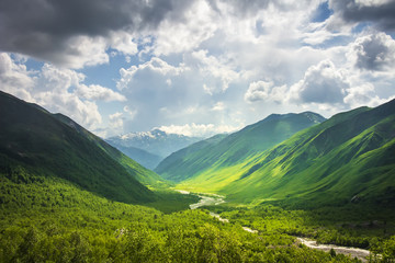 Alpine scenery. Wonderful mountain landscape of Svaneti highlands on sunny bright day. Beautiful georgian Caucasus mountains and hills. Amazing view on grassy hill in sunlight