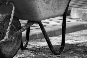Black and white photo with a wheelbarrow at the construction site