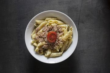 penne pasta on dark background