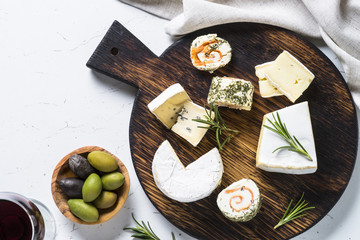 Cheese platter on white table.