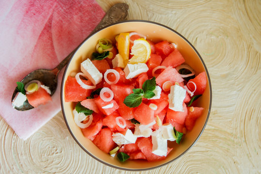 Summer light salad of watermelon, lime, mint and cheese