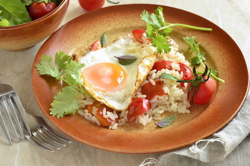 Rice with vegetables topped fried egg