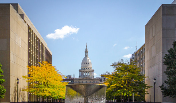 Lansing Michigan State Capitol Building. The state capital of Michigan with fall foliage on the downtown streets of Lansing Michigan.