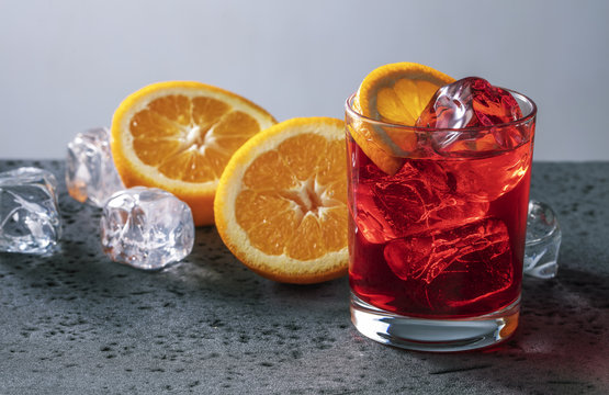 Cocktail with ice and orange.