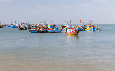 Fishing harbor full of boats in a bay in Mui Ne, Vietnam