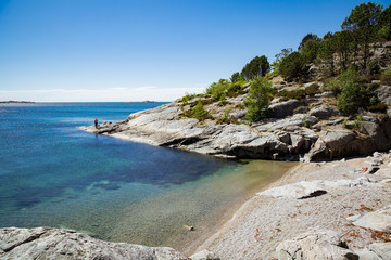 Deurstickers Noord Europa Serene scandinavian summer landscape on south coast of Norway. Sunny rocky beach with turquoise quiet water.