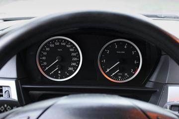 Car dashboard, illuminated panel, speed display