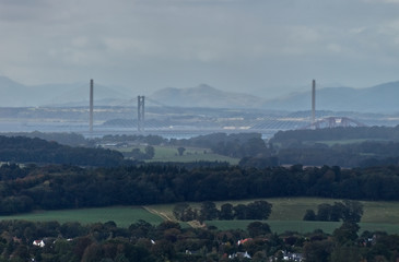 A photograph of the bridges over the Firth of Forth and rolling hills of the Midlothian Countryside near Edinburgh.