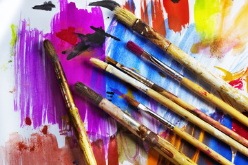 Paintbrushes on a colored paper