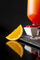Tequila sunrise and maraschino cherries