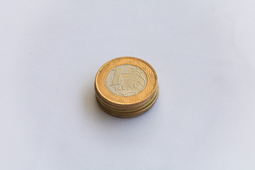 One real coins. Brazilian money. Selective focus. Brazilian currency. Economy, inflation, business. Front side. 1.