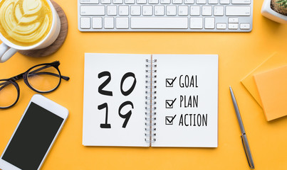 2019 new year goal,plan,action text on notepad with office accessories.Business motivation,inspiration