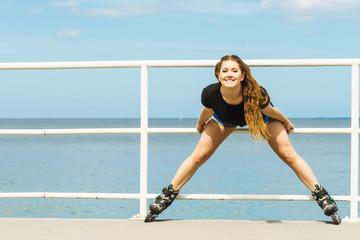 Girl wearing roller skates on seaside