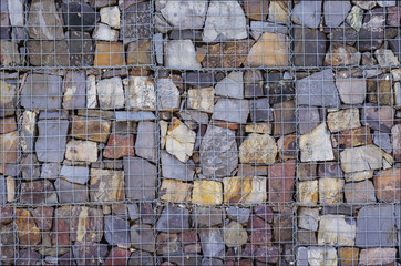 wall of stones placed behind the grid