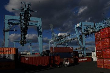 Shipping freight containers are transported at Dublin Port in Dublin