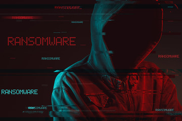 Ransomware concept with faceless hooded male person