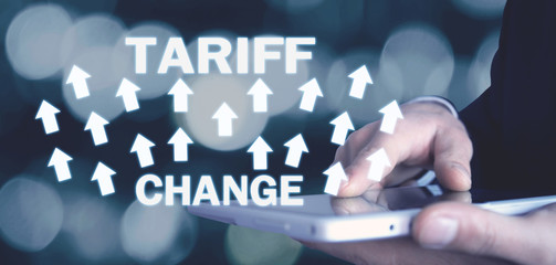 Man holding arrows with Tariff Change words. Business concept