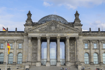 Portal of the Reichstag building (german government) with inscription Dem Deutschen Volke (to the German people) in Berlin the capital city of Germany, Europe, blue sky
