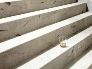 Drink in a glass on a stairway