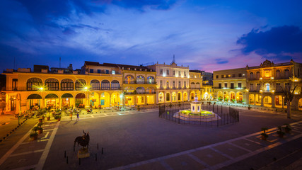 The Old Square, Plaza Vieja in Spanish, at twilight, Old Havana, Cuba.