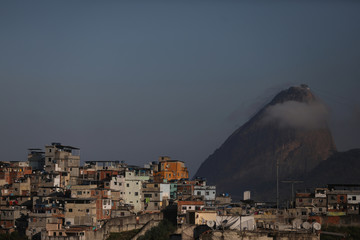 Houses at the Santo Amaro slum are seen with the Sugar Loaf mountain in the background in Rio de Janeiro