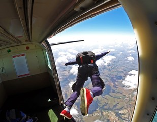 Photo sur Toile Aerien Skydiver jump out of plane