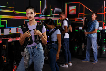 people looking laser guns and clothes together