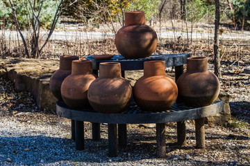 Large clay planters on a styand