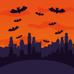 halloween city with bats flying scene
