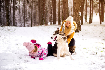 Happy family mother and child on winter