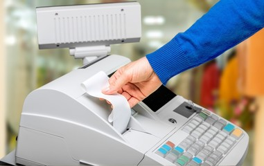 Fototapete - Cash register with LCD display and worker's