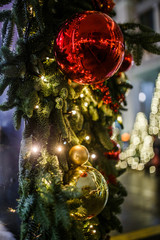 Photo of decorated fir tree with red and gold balls