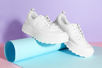 Wall Mural - Pair of stylish sneakers on color background