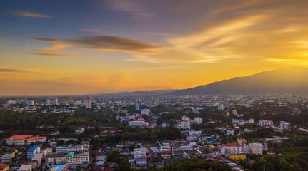 CHIANG MAI, THAILAND- AUGUST 7, 2018 : Aerial Panorama View of Chiang Mai City with sunset and twilight sky.