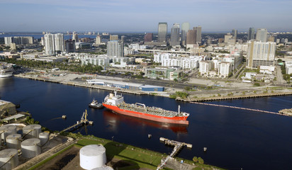 Little Tug Boats Do Double Duty Hauling Transport Ships in Port at Tampa