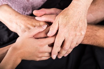 Man and Woman Hands Holding an Old Woman's Hands