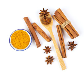 Close up the brown cinnamon stick and powder with star anise spice in wooden spoon isolated on white background