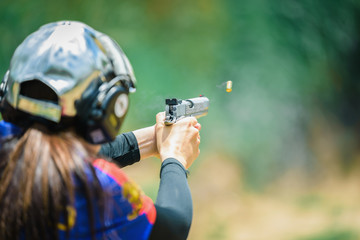 The woman's hands are practicing firing guns and shelling out.