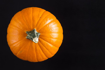 Orange Pumpkin on Black Table