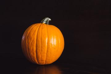 Orange Pumpkin on Brown Table