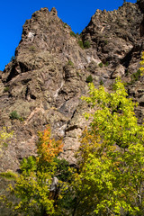 Colorful autumn foliage and rocky cliffs above the Gunnison River in Black Canyon of the Gunnison National Park in Colorado