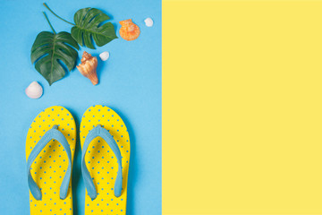 Yellow sandals on blue and yellow color background, Summer holidays accessories . flat lay photo