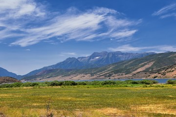 Panoramic Landscape view from Heber, Utah County, view of backside of Mount Timpanogos near Deer Creek Reservoir in the Wasatch Front Rocky Mountains, and Cloudscape. Utah, USA.