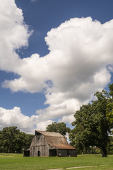 Vertical Composition Vintage Barn under Partly Cloudy Skies